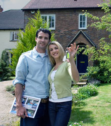 A happy couple who have just got the keys to their new house