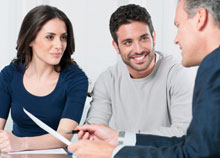 A couple speaking to an expert about conveyancing