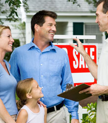 A family recieving the keys to their new property